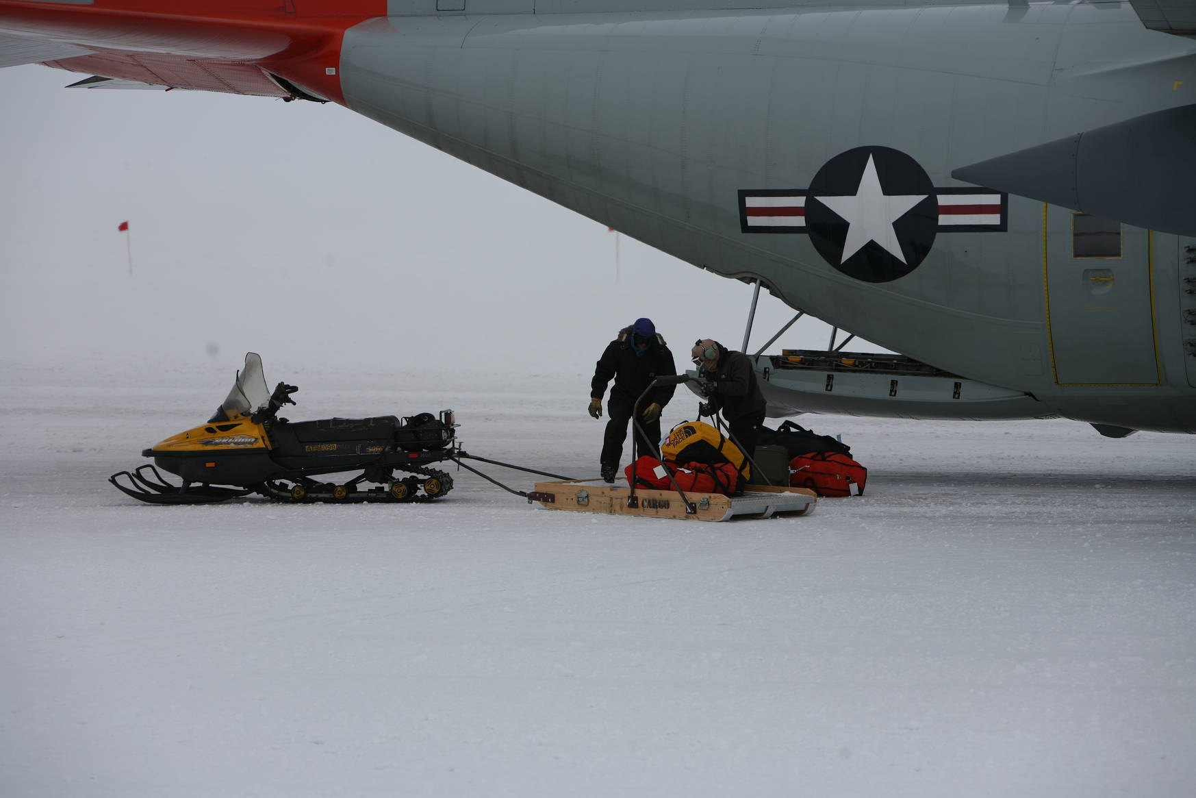 Passenger bags are brought to the aircraft by skimobile.