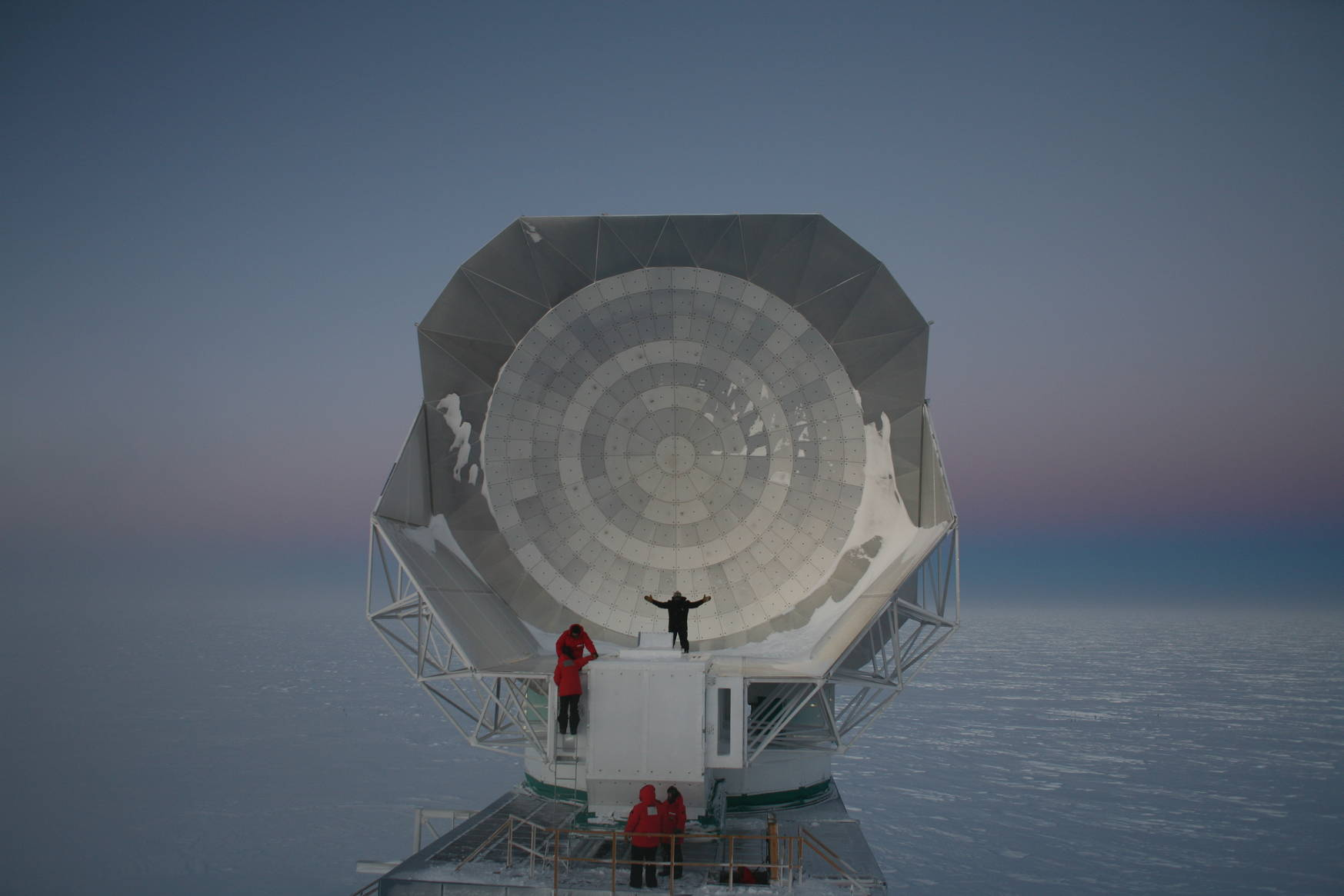 Visitors from station realizing just how large the south pole telescope really is.