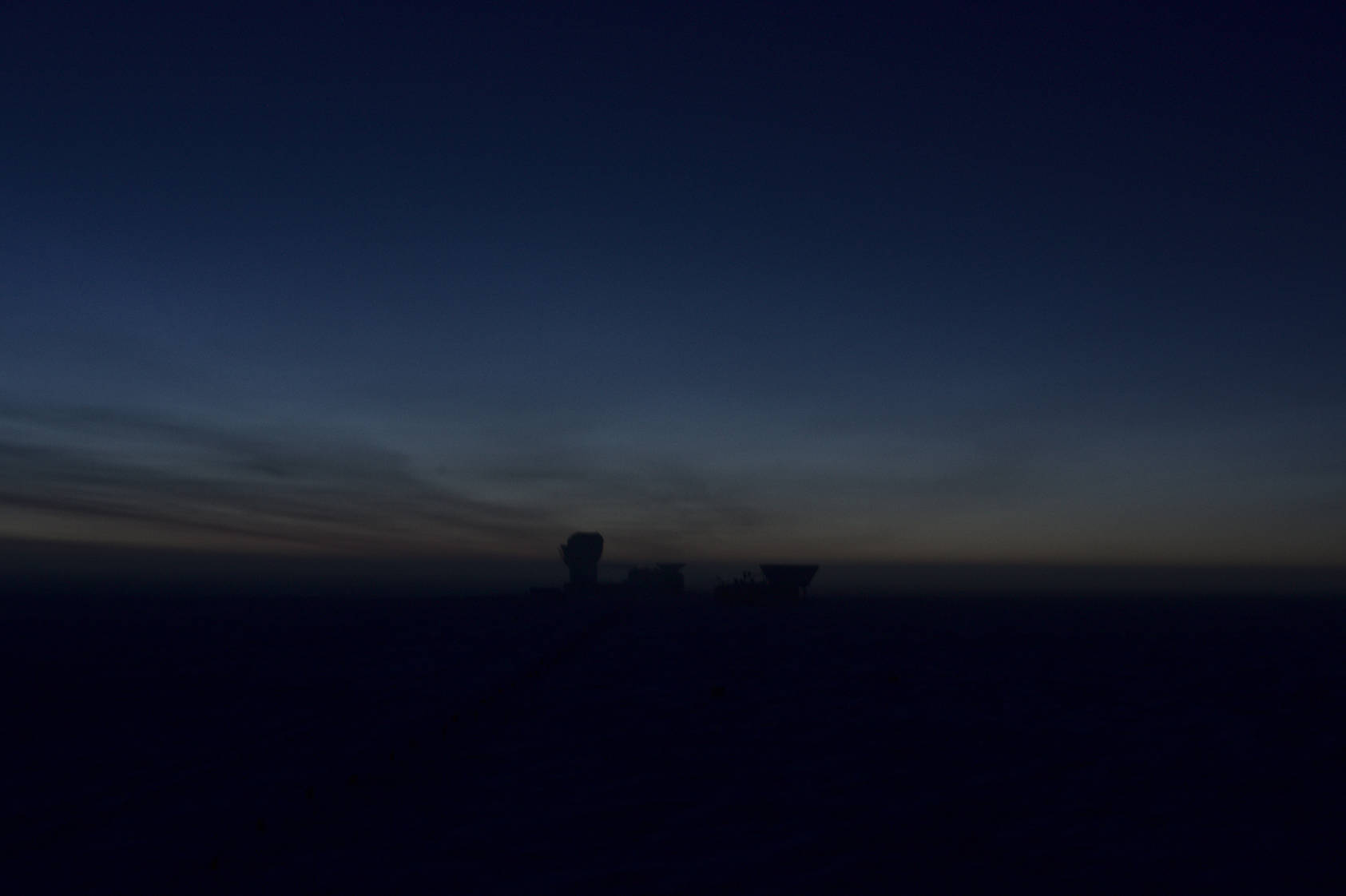A faint glimpse of light on the horizon behind the telescope... Just three more weeks until sunrise!